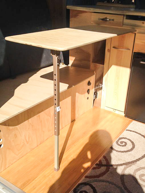 We built a table that attaches to the side of the cabinets.
