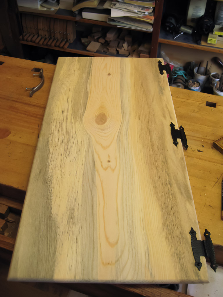 Our main cabinet door, made from Colorado beetle kill pine.