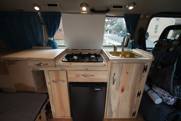 The counter top lifts up to access the stove and water tank.