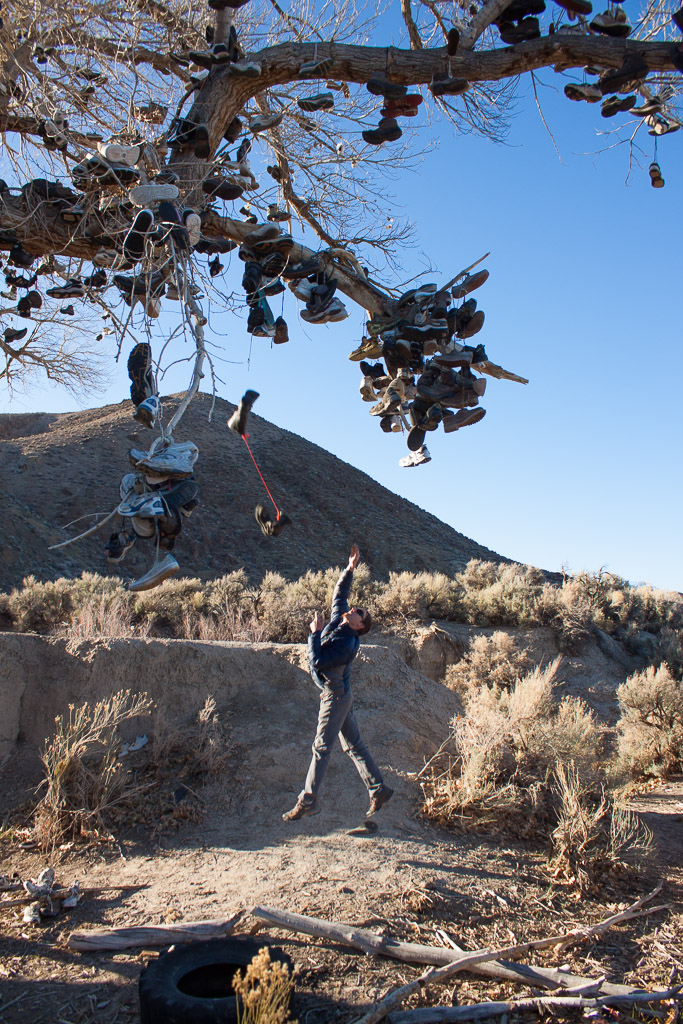 Tim flinging a heavy pair of boots at the shoe tree.