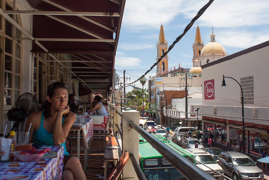 Emily observing the busy street after a delicious lunch in the Mercado Central.