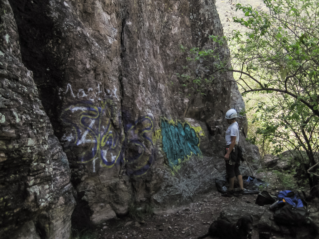 Tim checking out a the graffiti at the base of his next route.