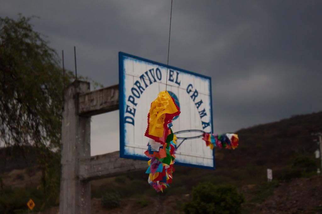 Basketball hoop with festive decorations in El Gramal.