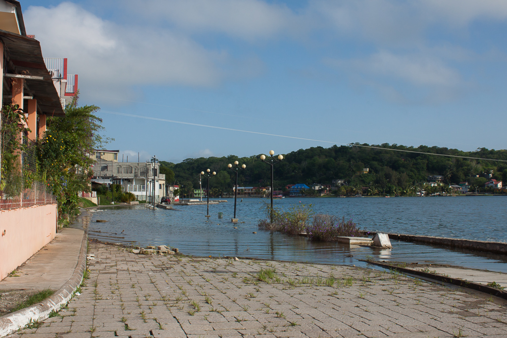 Lago Petén Itzá has been rising over the years, slowly submerging the streets and walkways that circle Flores.