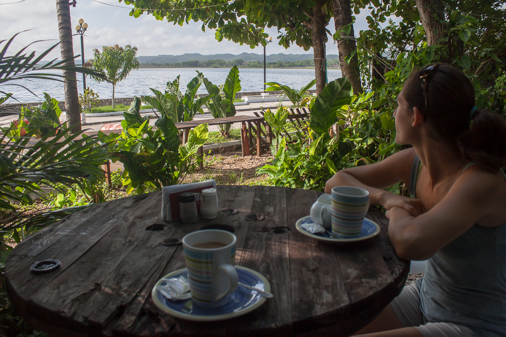 Emily enjoying the view and local, organic coffee in Flores.