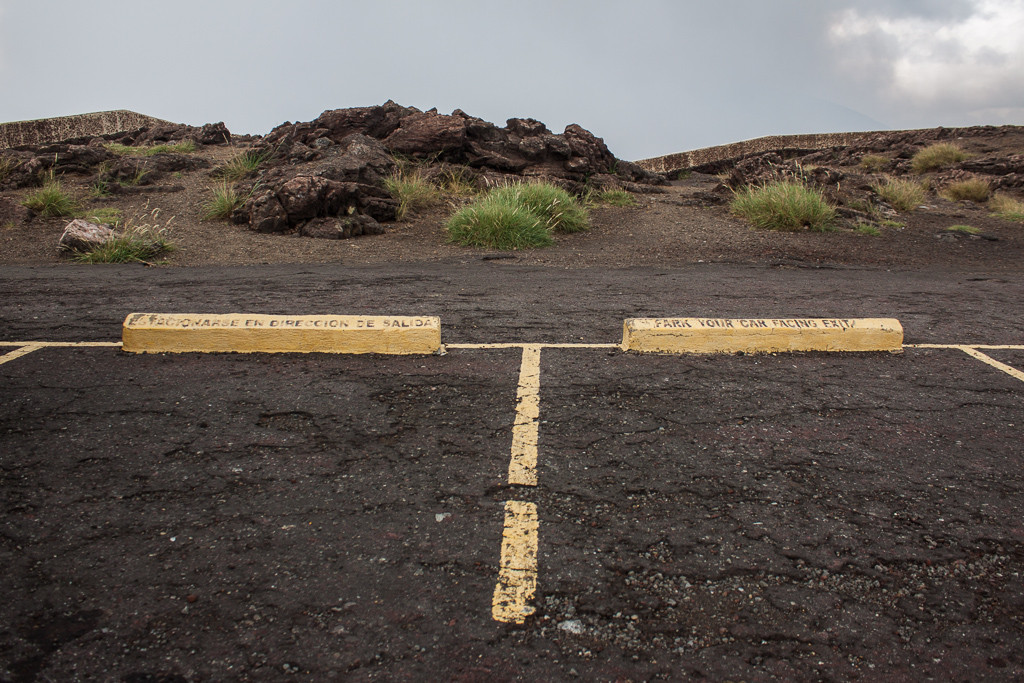 There are several signs instructing visitors to park facing outward at the caldera of Volcán Masaya, just in case it starts to blow...