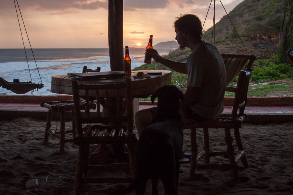 Cold beer + spectacular sunset + great waves = happy Tim.