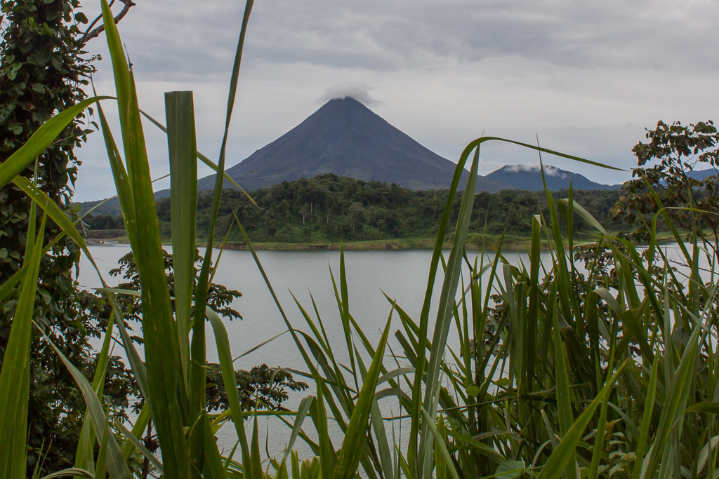 Our first glimpse of Volcán Arenal through the clouds.