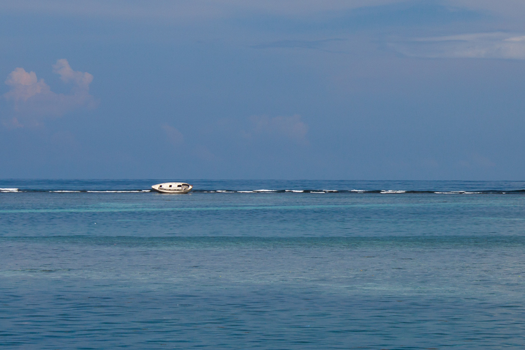 Shipwreck on a shallow reef.