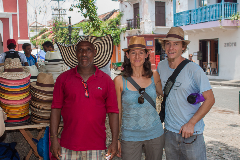 We were good tourists and bought some hats. The jovial vendor decided to pose with us.