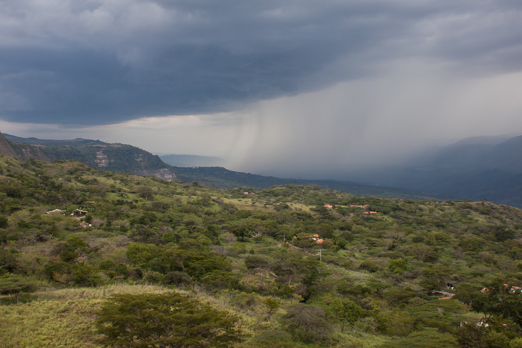 Rainstorm approaching the cliff where Chimera is parked on the edge of Barichara.