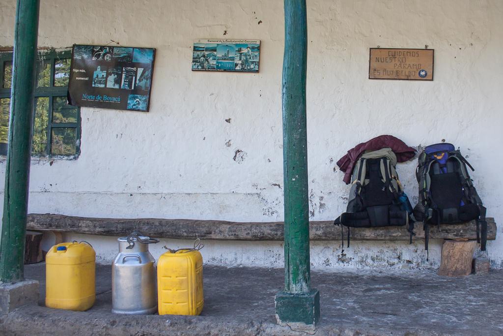 Backpacks and milk jugs waiting for el lechero.
