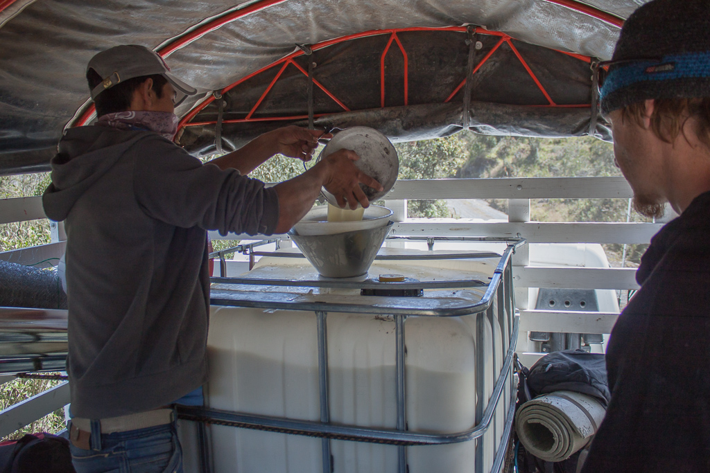Filling the 1000L container.