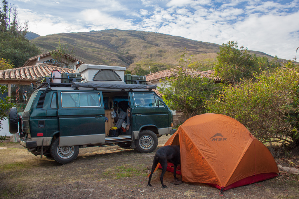 Our awesome camp spot just outside of Villa de Leyva. A big slobbery kiss from Hobie is always a good way to way up.