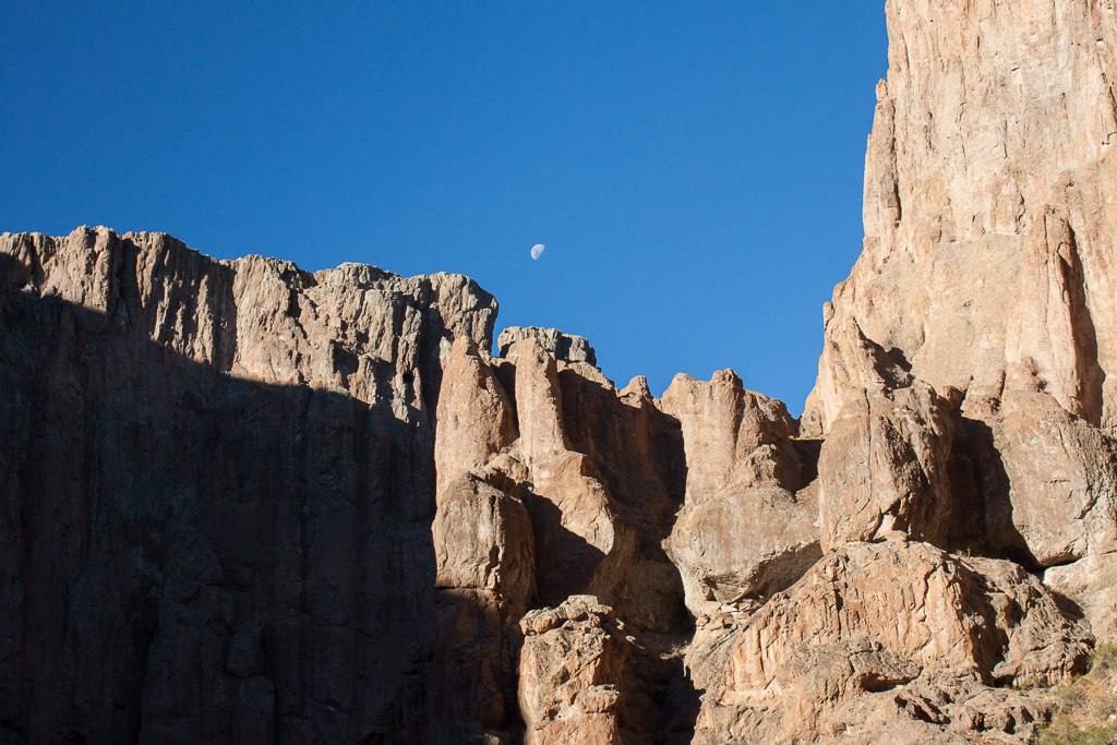 Moon over the canyon wall.