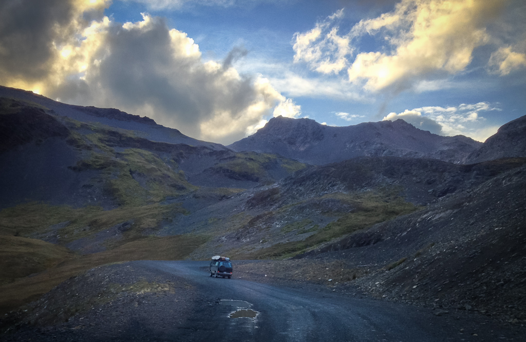 Climbing a stormy pass near the Chilean end of the road. Photo by Corey Axtell.