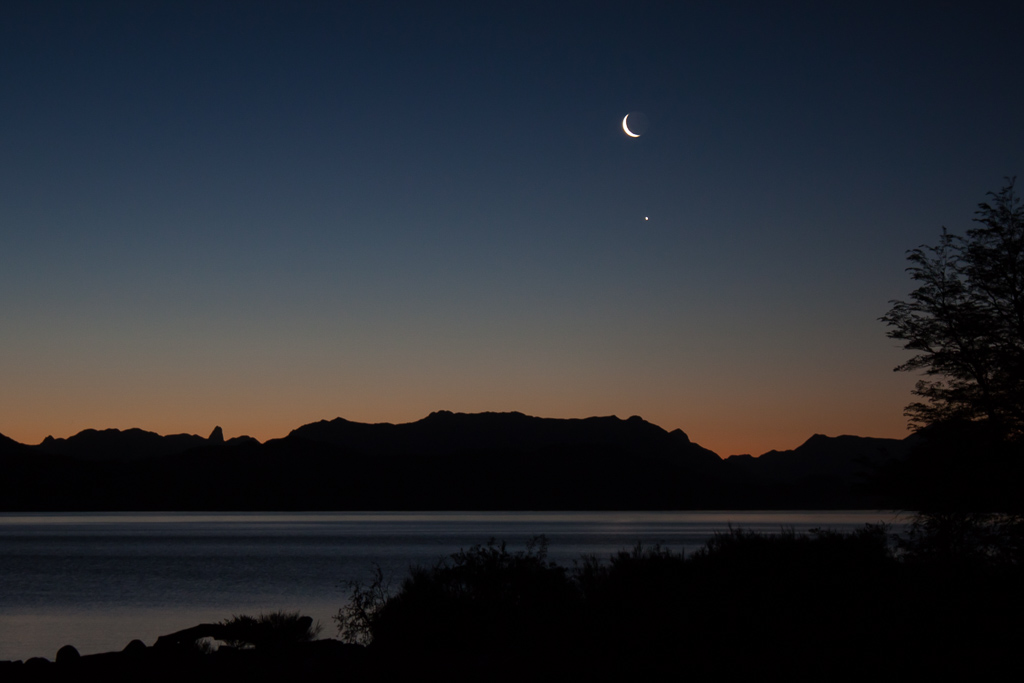 Crescent moon and Jupiter over Lago Nahuel Huapi.