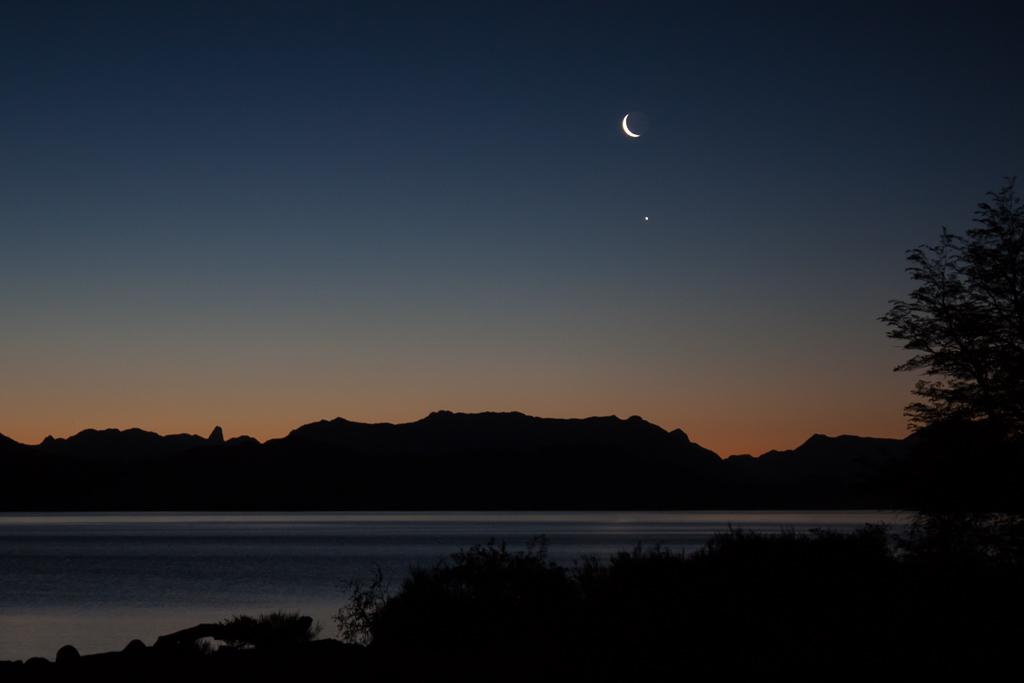 Crescent moon and Jupiter over Lago Nahuel Huapi.