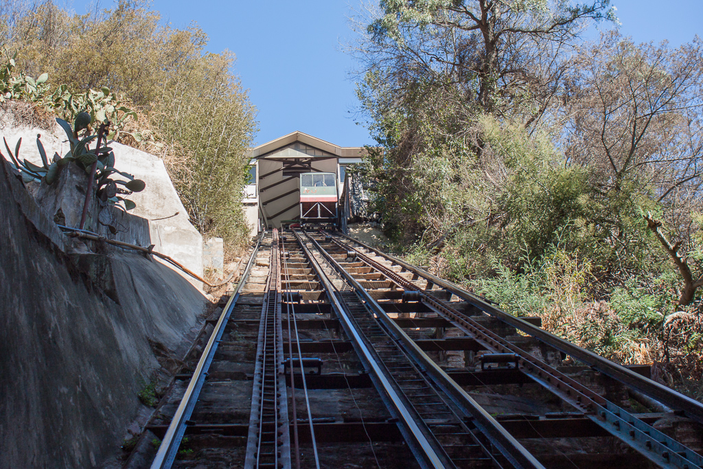 Riding one of the many old ascensors on the steep hills of Valparaiso.